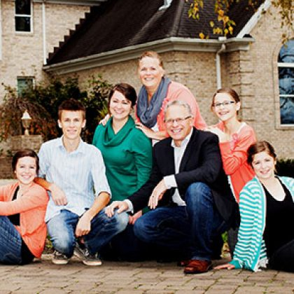 Golden Rule Builders, Inc. - Joel Barkman CEO and Family posing outside of home